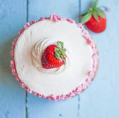 Strawberry cake with white cream on wooden background — Stock Photo