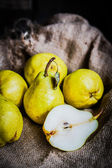 Pears on rustic wooden background — Stock Photo