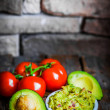 Guacamaole with bread and avocado on rustic wooden background — Stock Photo #43505597