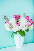Spring bouquet on blue background — Stock Photo