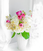 Spring bouquet near the window — Stock Photo