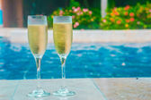 Champagne near swimming pool — Stock Photo
