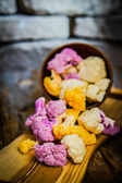 Colorful cauliflower on rustic background — Stock Photo