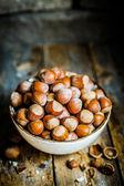 Hazelnuts on rustic wooden background — Stock Photo