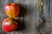 Apples on wooden background — Stock Photo