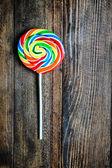 Lollipop on wooden background — Photo