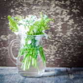 Rustic bunch on flowers — Stock Photo