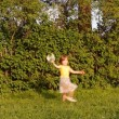 Little girl with a bouquet of camomiles  jumps, skips, runs, laughs — Stock Video