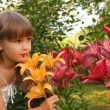 The girl among lilies, flowers smiles waves a hand — Stock Video
