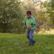 Boy dancing, somersaults, jumping on the grass — Stock Video