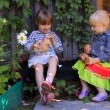 Two girls eating apples, playing dogs toys — Stock Video #31680255