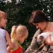 A mother with two children and a cat talking, laughing — Stock Video