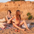 The mother and the two girls on the beach, a woman makes massage — Stock Video