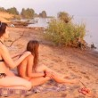 The mother and a girl on the beach, a woman makes massage — Stock Video