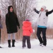 The girls and the children have fun in the winter nature — Stock Video #38320343