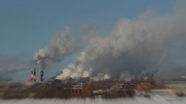 Winter fishing on the background of factory chimneys, cranes — Stockvideo