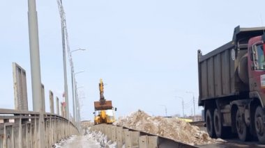 Snow removal equipment (excavator) cleans the road from snow — Stock Video