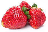 Three stawberries on the white background — Stock Photo