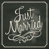 Just Married lettering sign on chalkboard background — Stok Vektör
