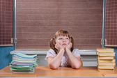 Schoolgirl in a classroom — Stock Photo
