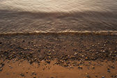 Waves on the river bank — Stock Photo