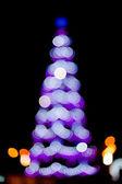 Blurred christmas tree lights — Stock Photo