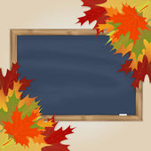 Maple leaves and grey chalkboard — Vector de stock