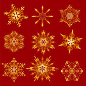 Golden snowflakes on a red background — Vecteur