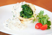 Squid stuffed with spinach — Stock Photo