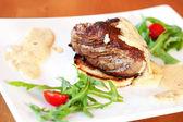 Veal tenderloin with gorgonzola sauce — Stock Photo