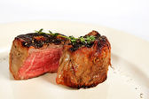 Filet mignon with rosemary twig — Stock Photo