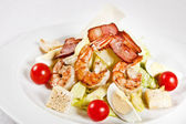 Caesar salad with prawns — Stock Photo
