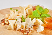 Assorted cheese plate — Stock Photo