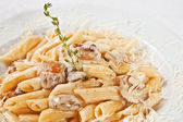 Penne with porcini mushrooms — Stock Photo
