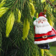 Santa Claus hanging on Christmas Tree — Stock Photo