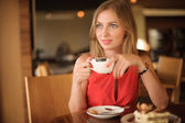 Pretty Young Woman in Cafe — Stock Photo