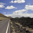 The road to the border of the lava fields. — Stock Photo