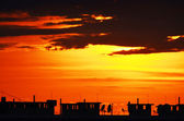 Sunset in a large, under construction city — Stock Photo