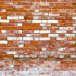 Foto de Stock  : Fragment of old brick wall