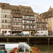 Cityscape in Strasbourg with a row of houses on an embankment — Stock Photo
