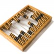 Old wooden abacus with a calculated sum. — Stock Photo