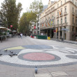 Boulevard Rambla with mosaic by Joan Miro. — Stock Photo
