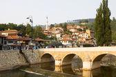 Sarajevo cityscape with the Miljacka river and a bridge — Stock Photo