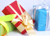 Color package with ribbon — Stock Photo