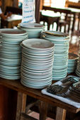 Stack of dishes for the buffet in the morning — Stock Photo