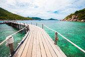 The wooden bridge at a beautiful beach — Stock Photo