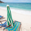 Stock Photo: Beach chairs and with umbrellon beach