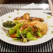 Snapper steak,Fried rice with butter and salads. — Stock Photo #41702875