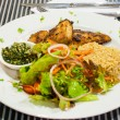 Snapper steak,Fried rice with butter and salads. — Stock Photo #41703875