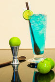 Blue lagoon cocktail with lime — Stock Photo